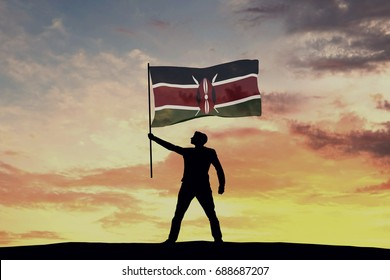 Male silhouette figure waving Kenya flag. 3D Rendering