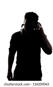 Male in silhouette listening to headphones isolated on white background