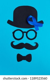 Male silhouette with mustache, glasses and hat patterns and blue ribbon symbol on the blue background. November concept. Prostate Cancer and men's health awareness.