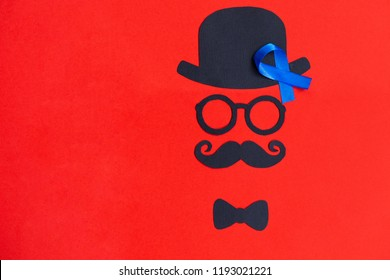 Male silhouette with mustache, glasses and hat patterns on the red background. Prostate Cancer and men's health awareness. Funny party faces. Copy space