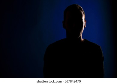 male silhouette on a blue background