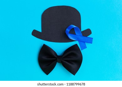 Male silhouette pattern with blue ribbon symbol on the bright blue background. November concept. Prostate Cancer and men's health awareness. Top view