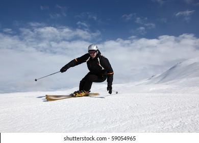 Male skier having fun on the slope in Davos-Pischa, Switzerland.