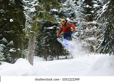 male skier jumping high in the forest