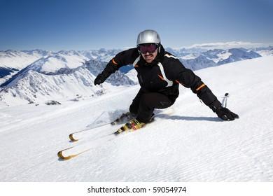 Male skier with mountain view in Davos-Pischa, Switzerland