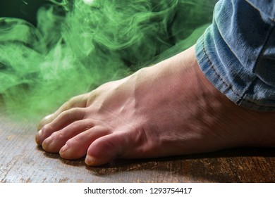 Male smelly foot with colorful visible odor vapor