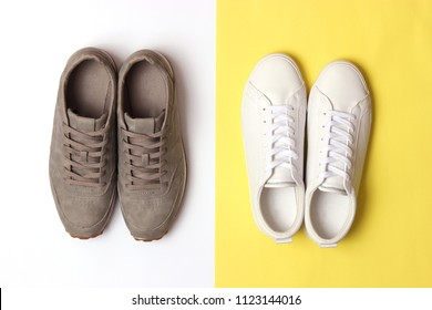 male sneakers and sneakers on a colored background top view. men's footwear. minimalism