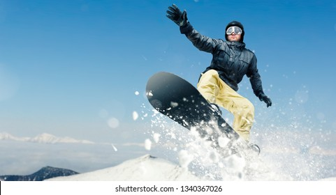 Male snowboarder, dangerous downhill in action