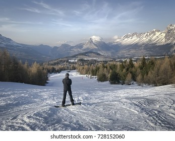 Male snowboarder on ski run slope with Alps snow background Joue du Loup