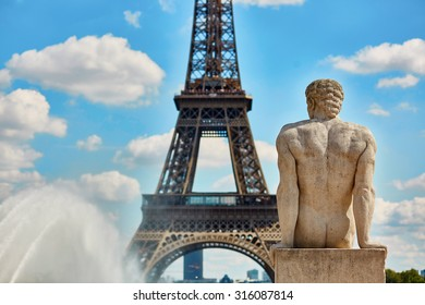 Male statue on the Trocadero view pont in front of the Eiffel tower