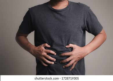 Male Stomach Pain On White Background / Healthcare and Medical Concepts