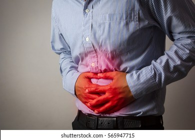 Male stomachache or Gastroenterologists / Concept with Healthcare And Medicine.