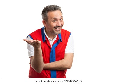 Male store owner or hypermarket employee making obvious solution gesture with palm and trustworthy expression isolated on white