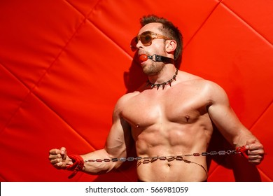 Male stripper on a red background.