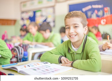 male student at the class smiling
