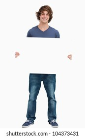Male student holding a white board against white background