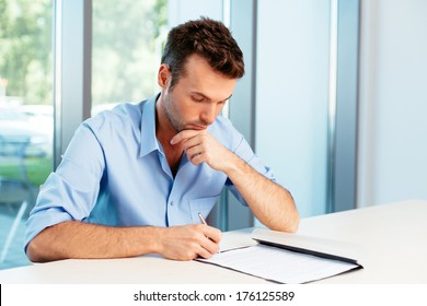 Male student taking some notes
