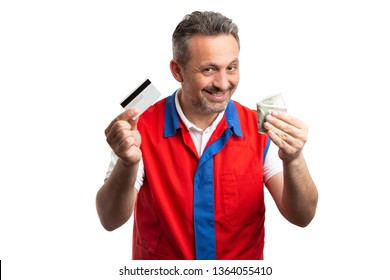 Male supermarket or hypermarket employee with trustworthy expression holding cred card and money bills isolated on white studio background