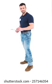 Male supervisor writing on clipboard over white background