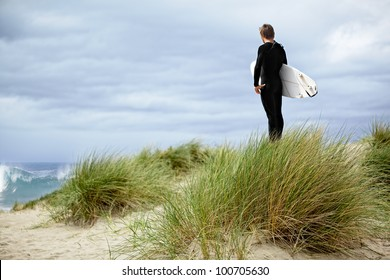 Male Surfer At The Beach, Standing In Green Sea Grass Sand Dunes On The Coast Of California ~ Boy On Vacation With Surf Board ~ Pacific Ocean Athletic Sport