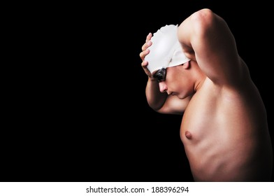 Male swimmer isolated on black