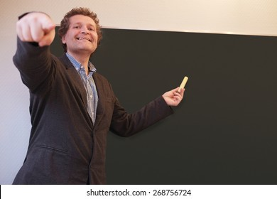 Male teacher calling on student to answer a question