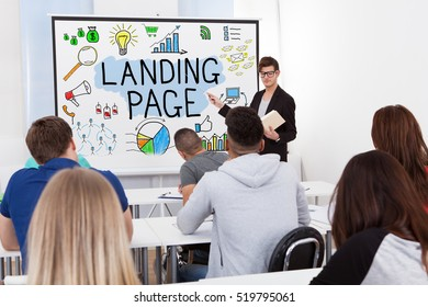 Male Teacher Explaining The Concept Of Landing Page To Students In Classroom