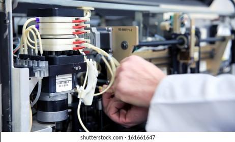 Male technician preparing laboratory equipment at Hospital laboratory
