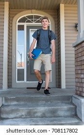 Male teenager leaving home to go to school.