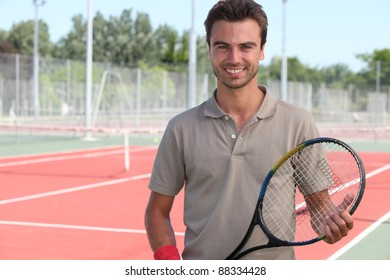 Male tennis player on a hardcourt