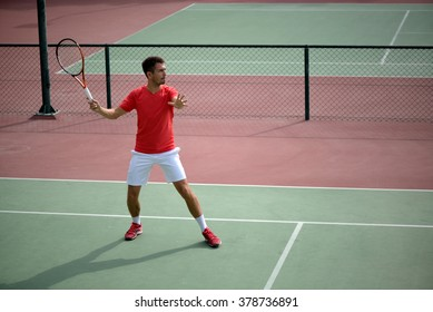 Male tennis player practice in tennis court in Dubai.