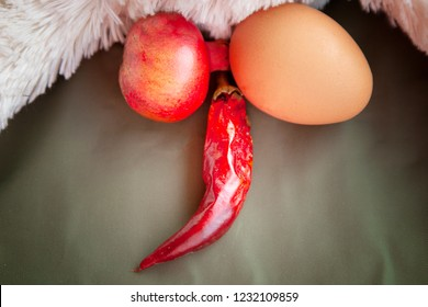 Male testicles, in the form of chicken eggs and pomegranates, red pepper in the form of a penis. Disease of the male genital organs. sore testicles enlarged. Testicular cancer