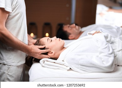 Male Therapist making spa head massage to a female client. Manual therapy, osteopathy concept. Health and Body Care Concept .