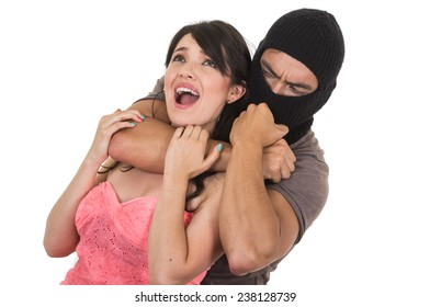 male thief holding strangling young scared girl isolated on white