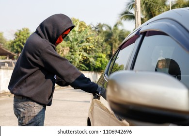 Male thief tries to steal a car. Car theft concept