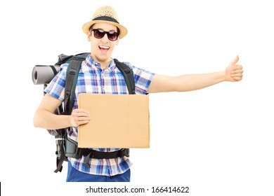 Male tourist with backpack hitchhiking isolated on white background