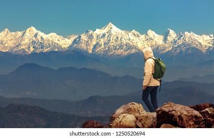Male tourist hiker admire the majestic Kumaon Himalaya range at Munsiyari Uttarakhand India.
