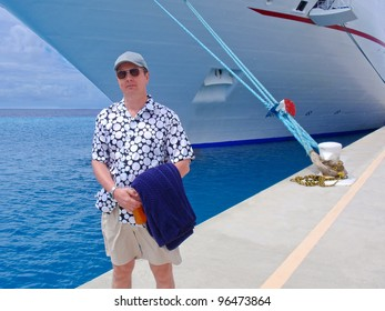A male tourist over the passenger ship in port.