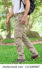 male tourist in the park. Tourism and travel concept, cargo pants