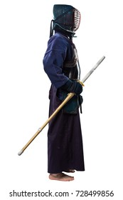 male in tradition kendo armor with shinai (bamboo sword). shot in studio on white background
