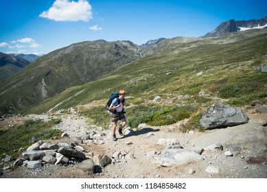male traveler hiking on Besseggen ridge in Jotunheimen National Park, Norway