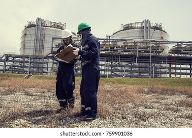 Male two worker inspection visual pipeline oil and gas