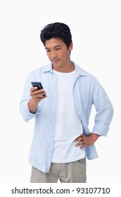 Male typing text message against a white background