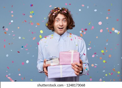 Male was unexpectedly congratulated by all friends, presented beautiful packed gifts, the holiday was a success, the guests pleased the birthday man, he was pleased, happy and surprised