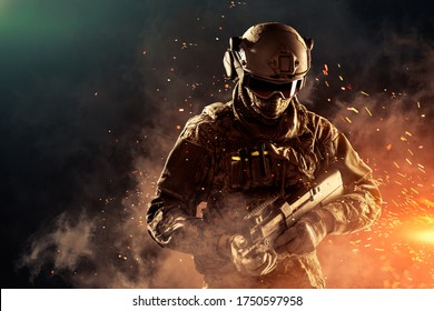 Male in uniform of Tactical Units of Police with weapon. Shot in studio. Explosion, smoke and fire sparks on a black and green background (Poster design, flip)