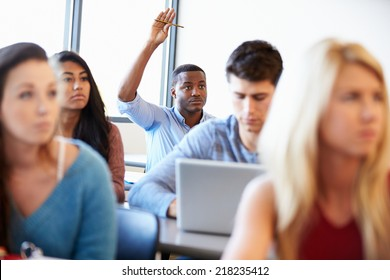 Male University Student Using Laptop In Classroom
