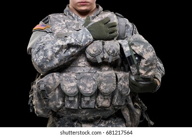 male in US Army soldier (ISAF) uniform. Shot in studio. Flag of USA on background