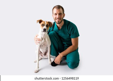 Male Vet with cute Hound Puppy