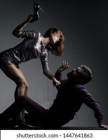 Male victims of sexual assault. An attractive woman is beating a man with heels