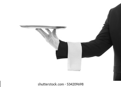 Male waiter holding tray on white background
